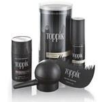 Toppik produkter - tre sorte beholdere merket Toppik, en børste og en blåse